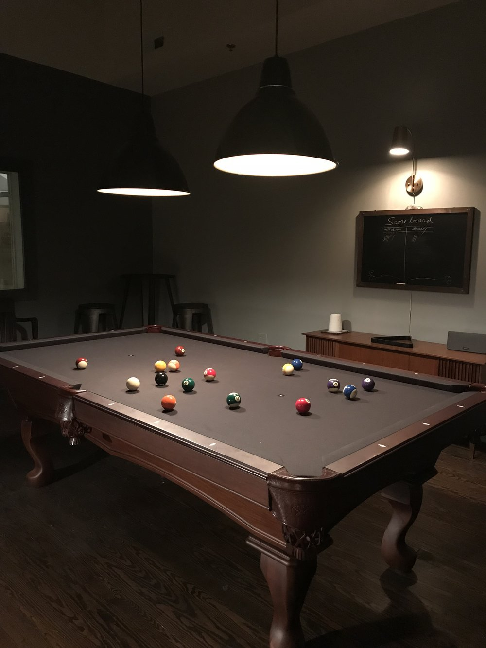 Our game room has an 8' Olhausen billiards table along with foosball and vintage arcades.