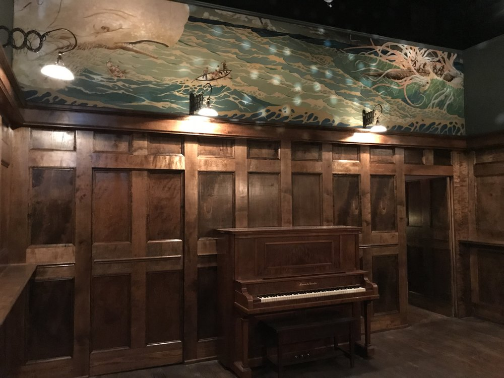 Our hand-built bar, complete with Mason & Hamlin upright grand piano, has hosted intimate live performances for over five years.