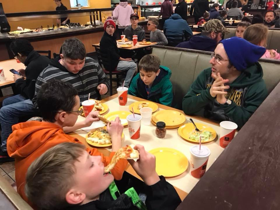 Middle School Guys chomping down on CiCi's Pizza!