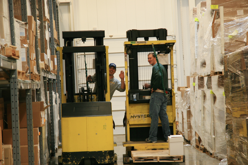 warehouse workers search packages