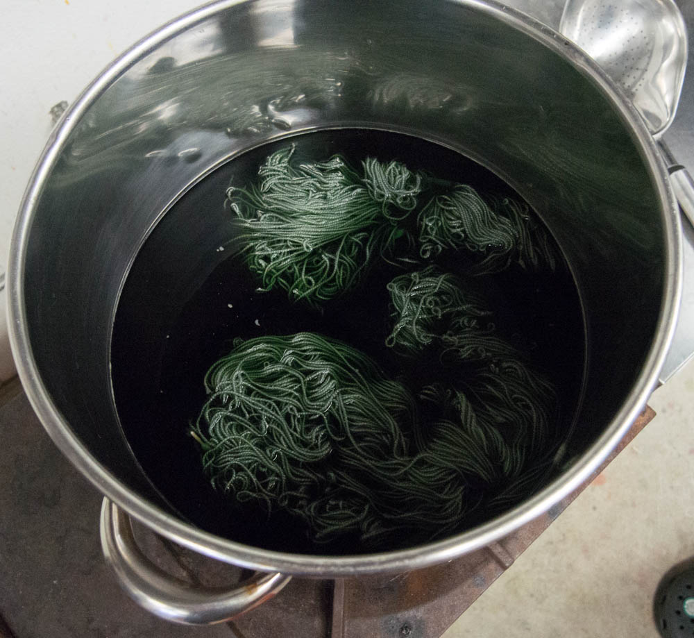 green yarn cooking in kettle.jpg