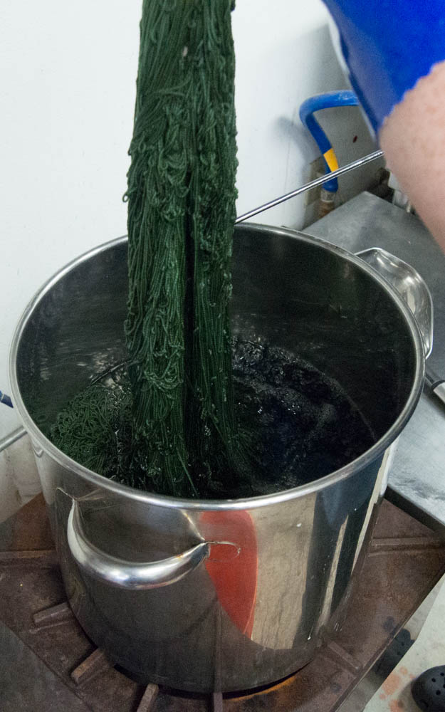 pulling green yarn out of kettle.jpg