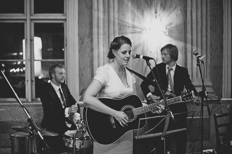 bride playing guitar