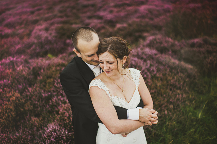 wedding photographs on yorkshire moors with heather in bloom