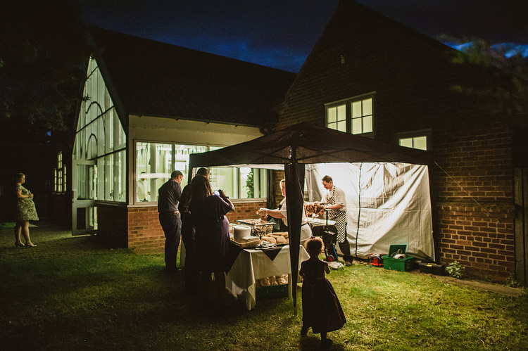 Pig on a spit at English village hall wedding