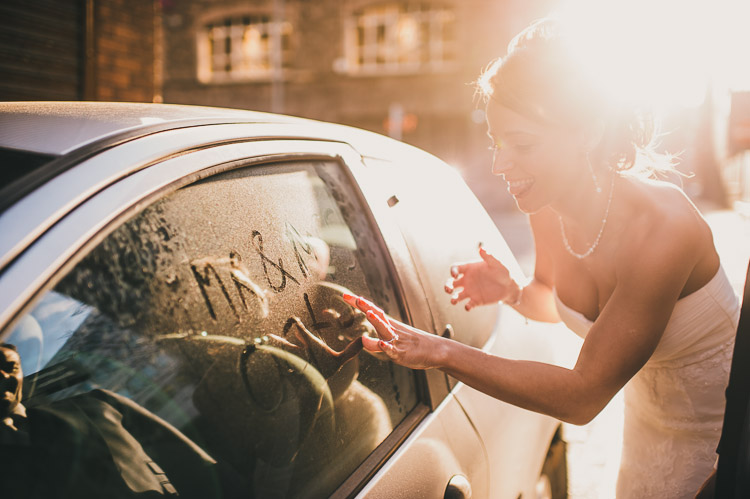bride writing in car window mr & mrs