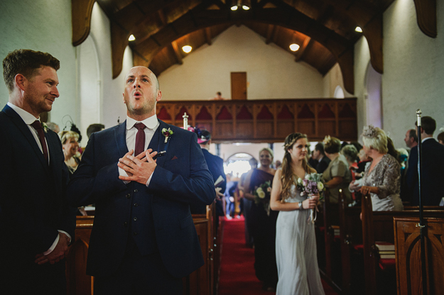 Just a classic groom/aisle shot. Made all the better because there aren't ten people hanging out of the pews with iPads and phones obscuring the action, Some photographers like to have 'unplugged'  ie. technology-free -  ceremonies. I wouldn't go that far, but there's no denying it messes up otherwise lovely photos on a regular basis!