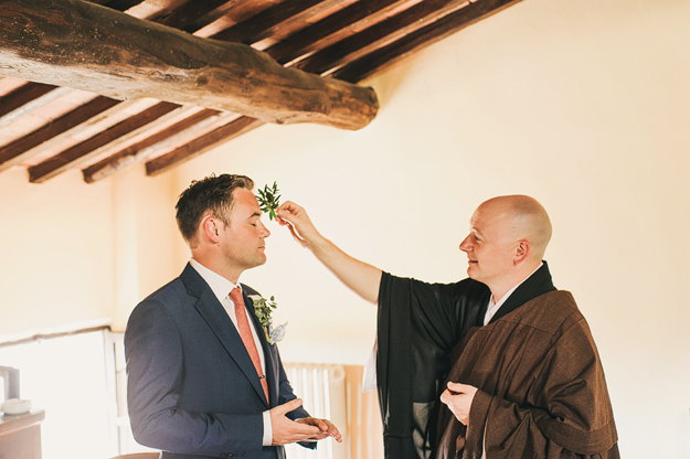 Love it when people get their families involved. This is Mark's brother , who is a Buddhist priest, blessing him before the ceremony.