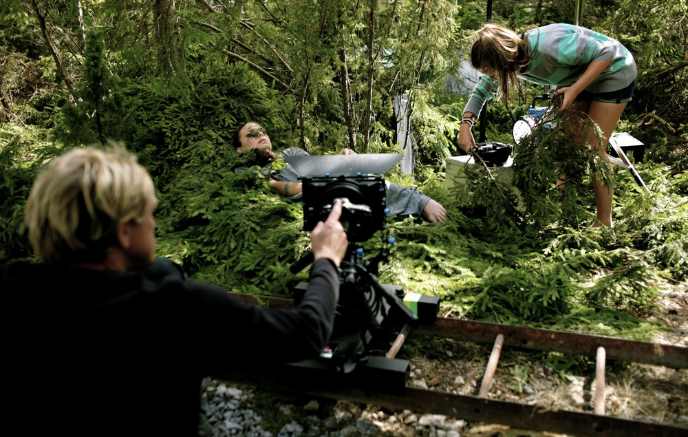 Cinematographer Pär Eliasson setting up the Wake Up Scene in the woods at Gotland.