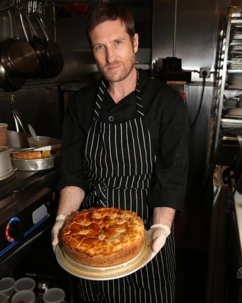 Edible History executive chef holding baked pie.jpg