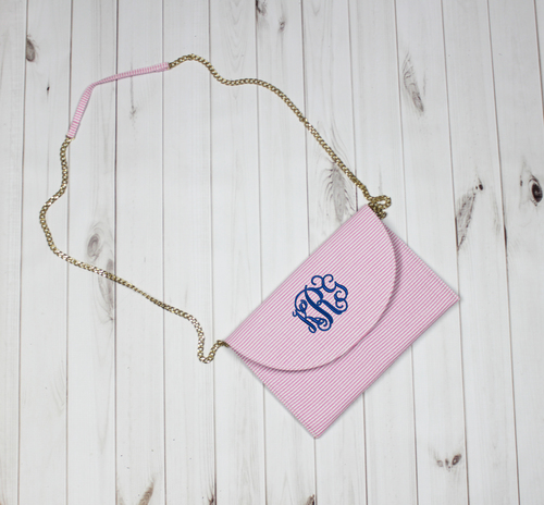 This monogram  crossbody  will be your new favorite bag for Spring! Not only is it lightweight, but the pink (or blue) seersucker will brighten up any outfit!