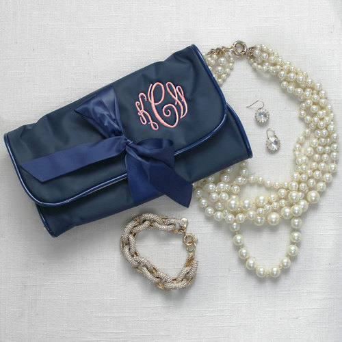 Our monogrammed roll-up jewelry  pouch  is the perfect way to store all your wedding day baubles. Transition in your fun honeymoon accessories for travelling!