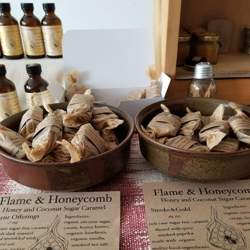 Flame and Honeycomb brings an eclectic line of small batch, magically charged creations based out of Northampton, MA.  Miel Rose makes infused honey sweetened chocolates and caramels, infused honey and oils, herbal skin creams and more.  -
