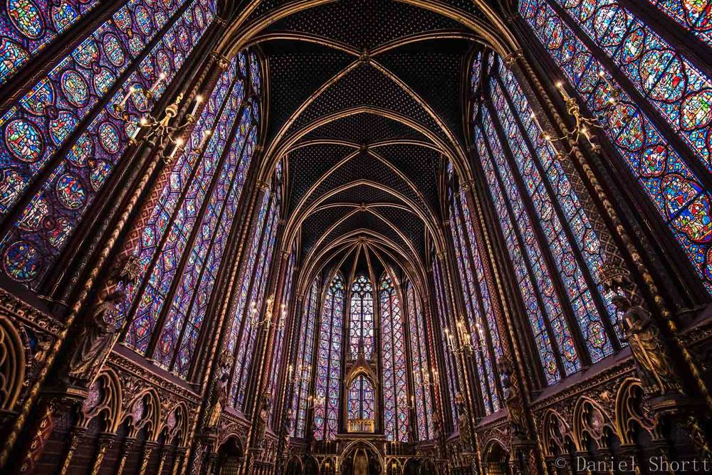 A glorious view of the stained-glass inside of Sainte Chapelle.