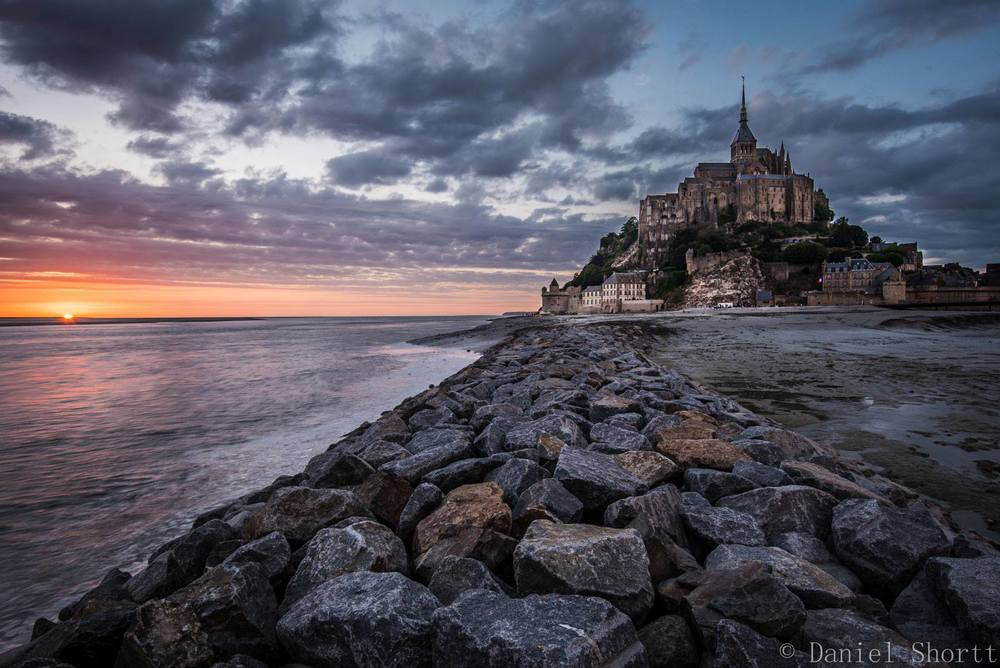 An epic sundown vision of Mont Saint-Michel.