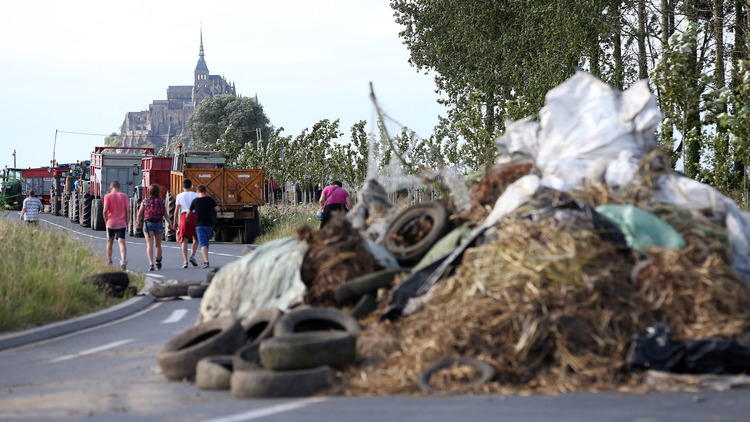 This is an example of the blockades caused by the angry farmers. It stopped the tourists getting to their hotels outside Mont Saint-Michel.