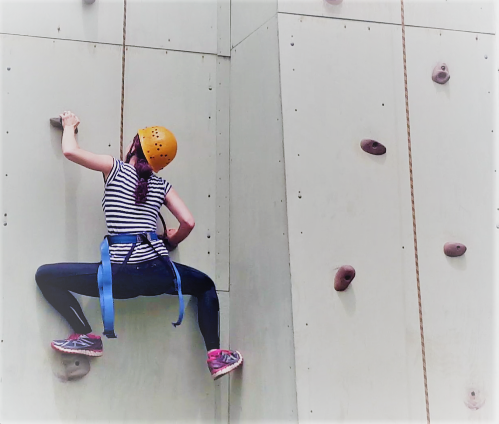 Just one of the many awkward positions I got myself into attempting to rock-climb in front of my students!