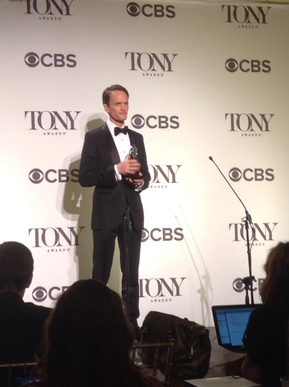 Neil Patrick Harris winning the 2014 Tony Award.