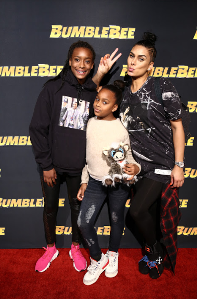Laura Govan & family attend the Glammed-Out Auto Clinic at West Coast Customs on behalf of BUMBLEBEE, in theatres December 21 (Photo Credit: Steven Baffo)