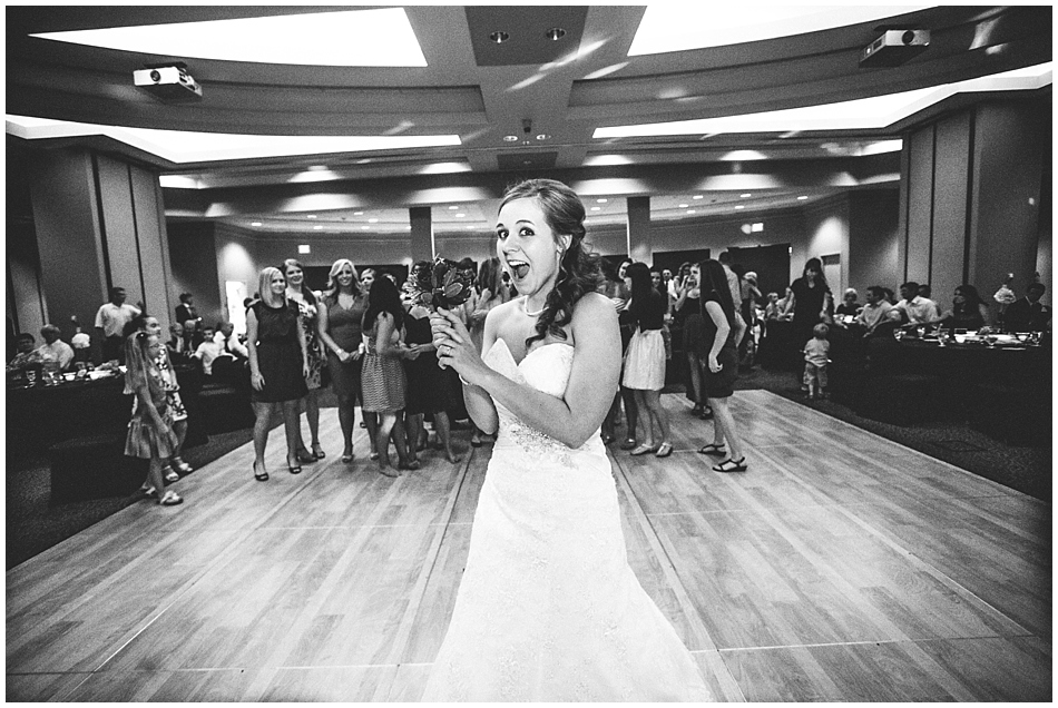 Bride throwing her bouquet at Scott Conference Center Omaha