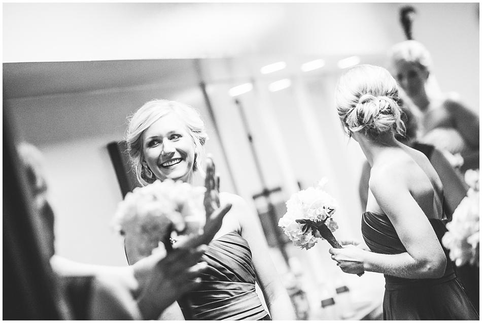 bridesmaids laughing in st. margaret mary basement, Omaha, ne