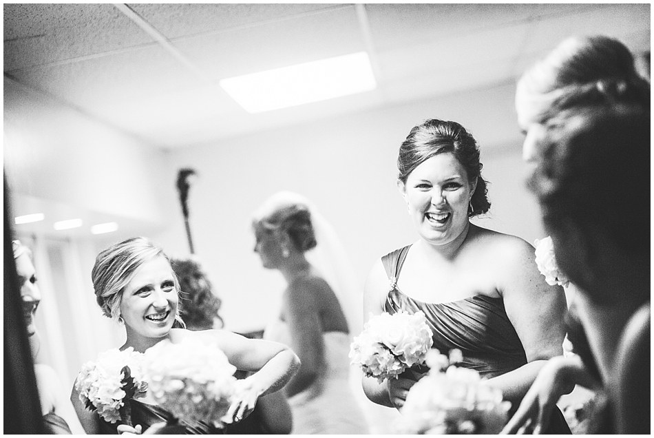 bridesmaids laughing during getting ready in church basement