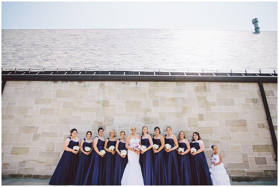 modern bridesmaid shot at church against the wall