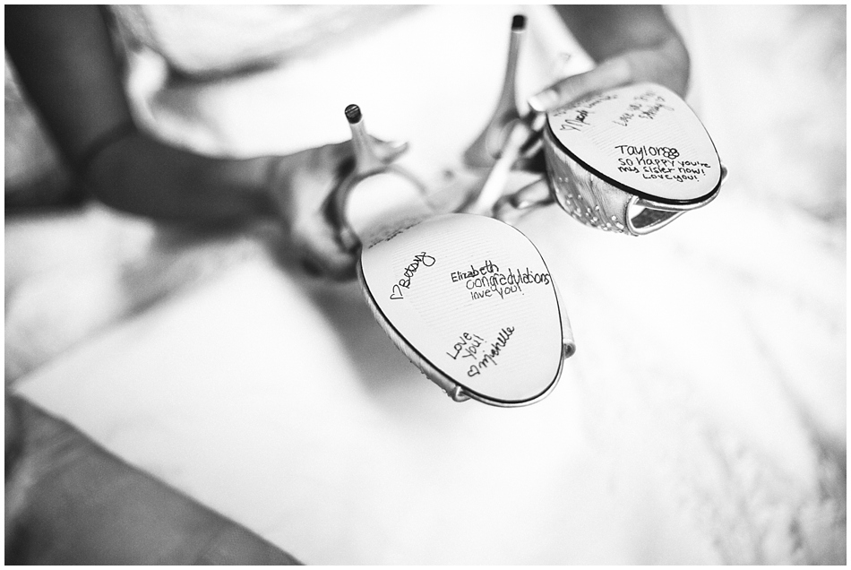 Bridesmaids writing notes on wedding shoes