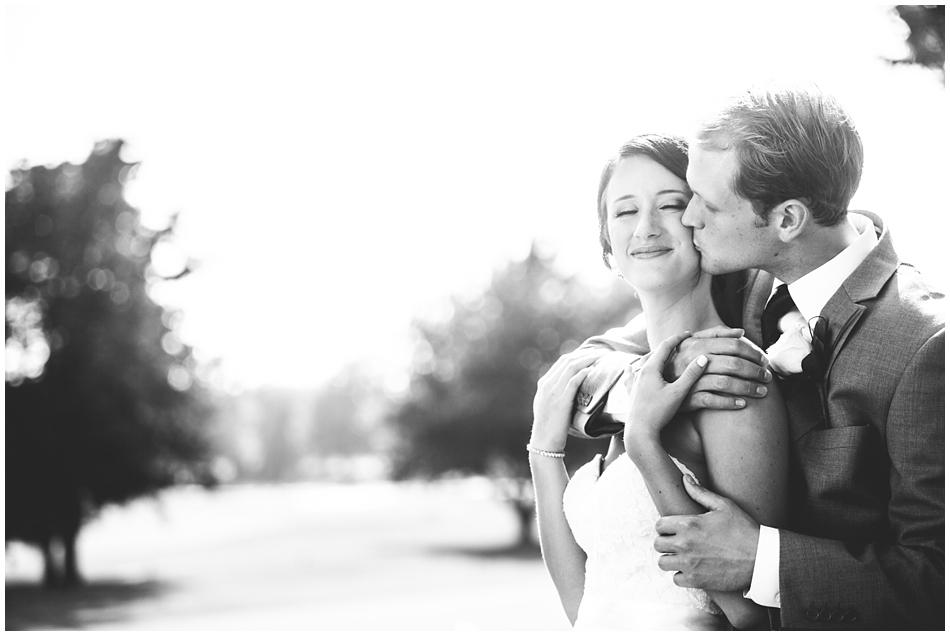 Groom giving bride a hug at Omaha Country Club, Omaha, NE