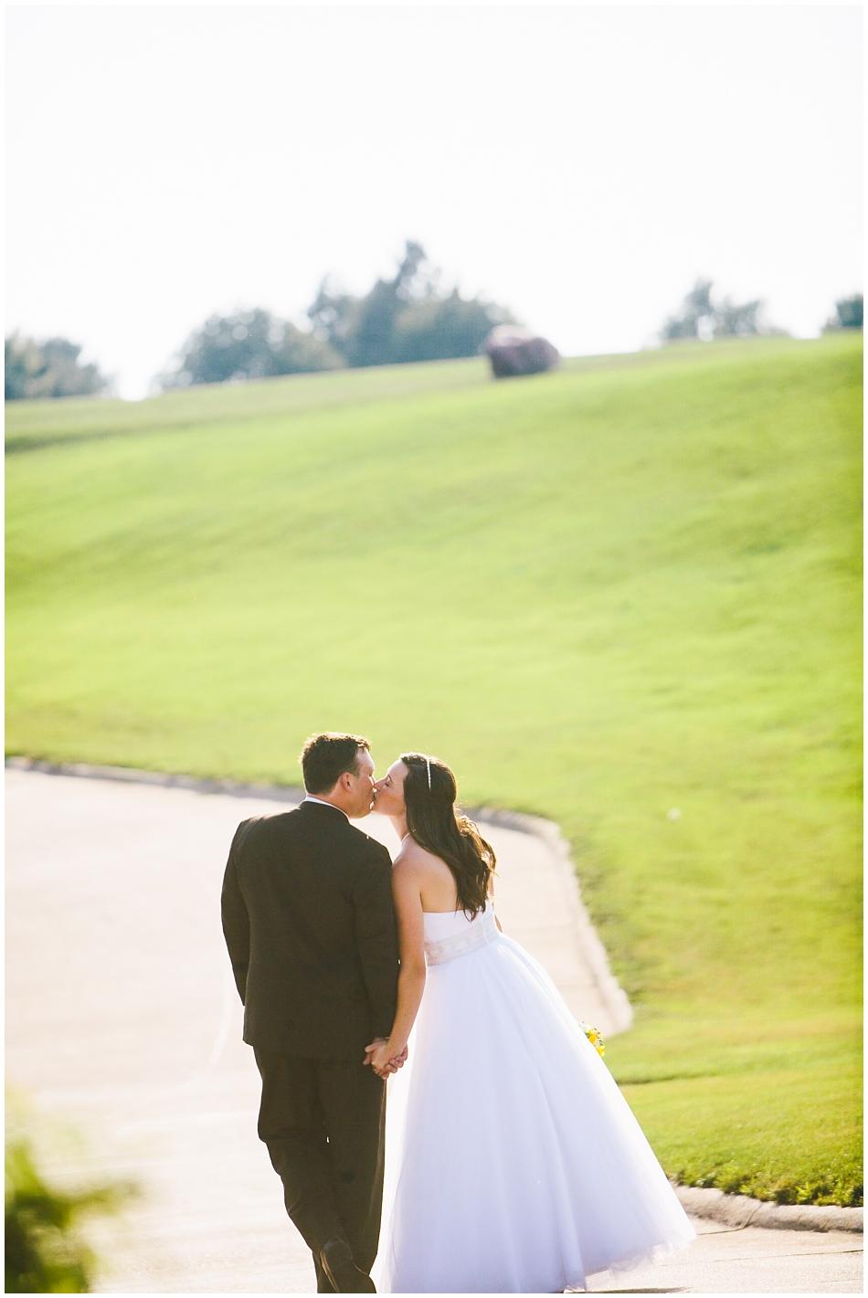 Bride and Groom walking away on wedding day in Omaha, Nebraska