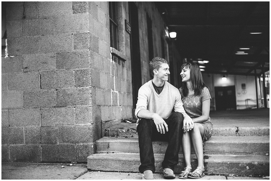 Cute couple hanging out on step in downtown Omaha, Nebraska