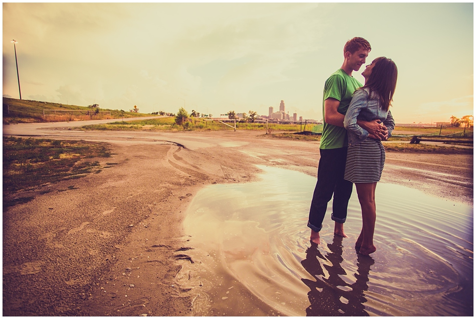 couple standing in a puddle together