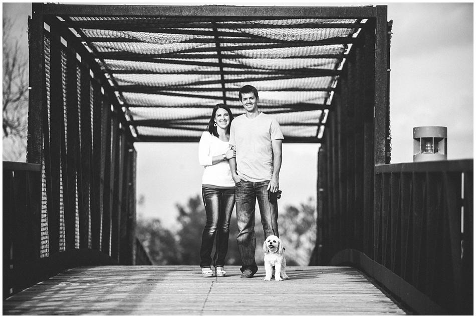 Black and white photo of couple on bridge for engagement photos