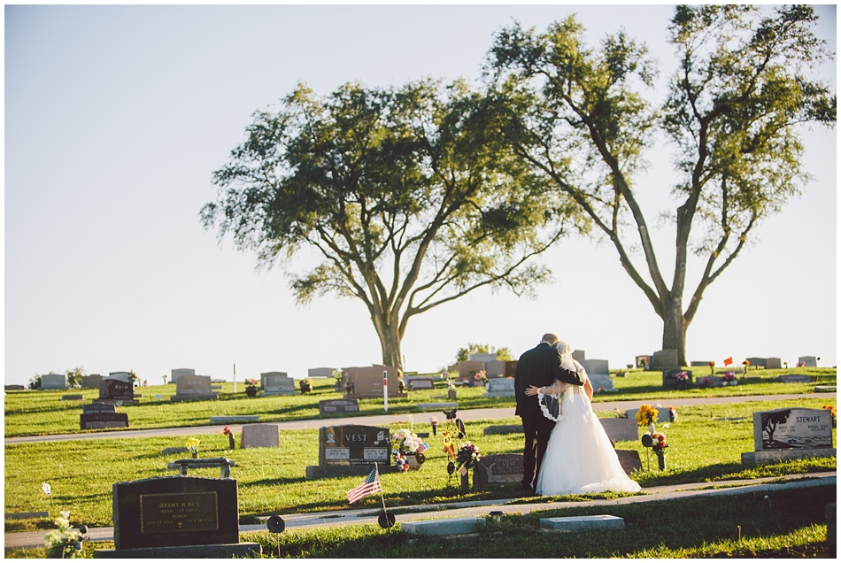 bride paying respect to father at cemetary