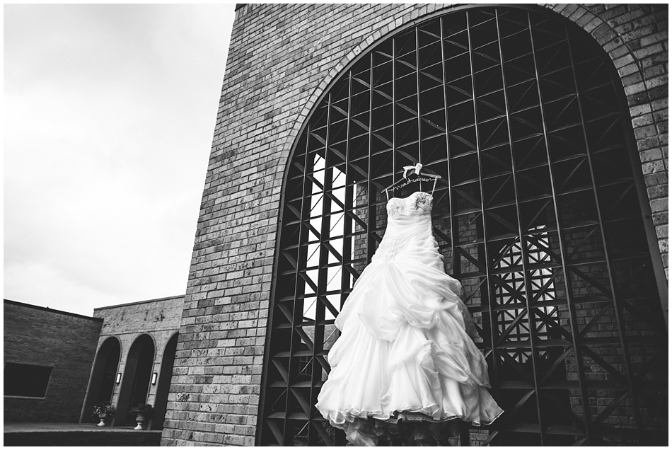 Wedding dress hanging at St. John Vianney, Amanda Kohler Photography, Omaha NE