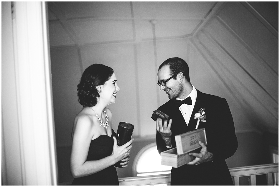 Groom opening gift from his bride