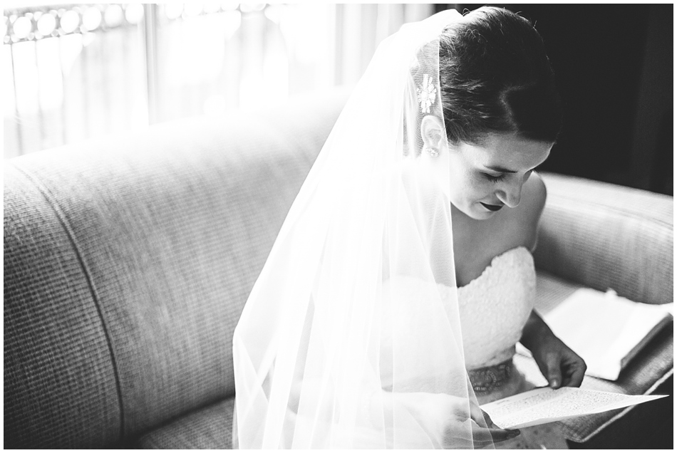 Bride reading letter in Magnolia hotel, Omaha, NE