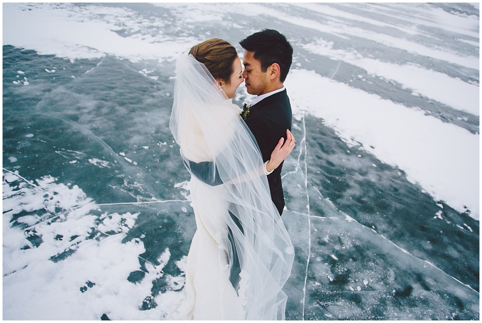 bride and groom on frozen lake