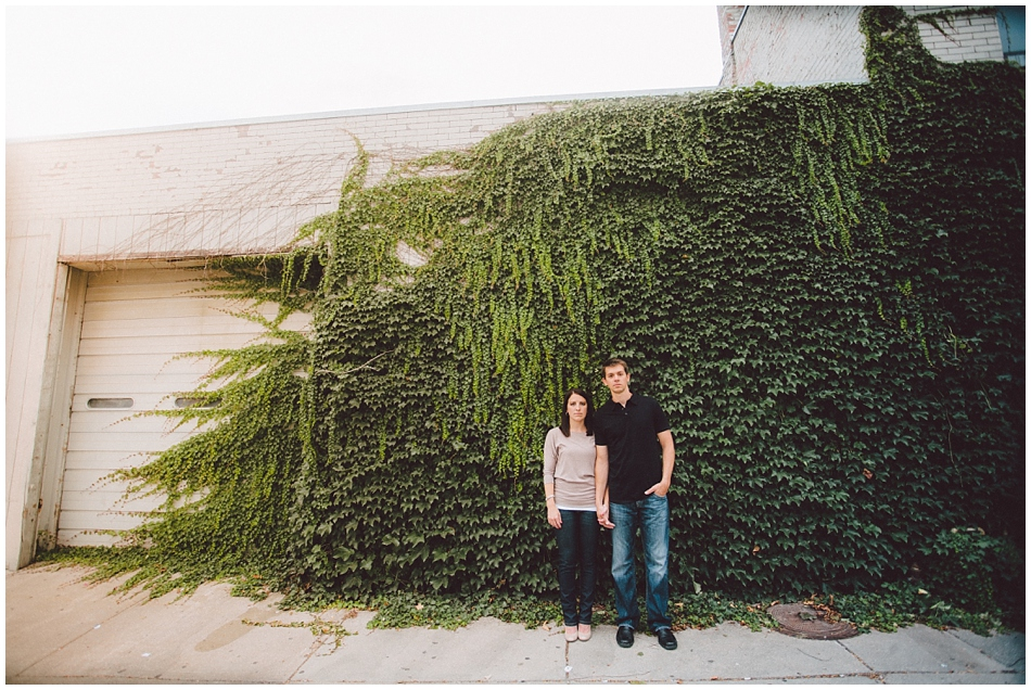 Downtown Omaha, NE engagement shoot with green ivy on building