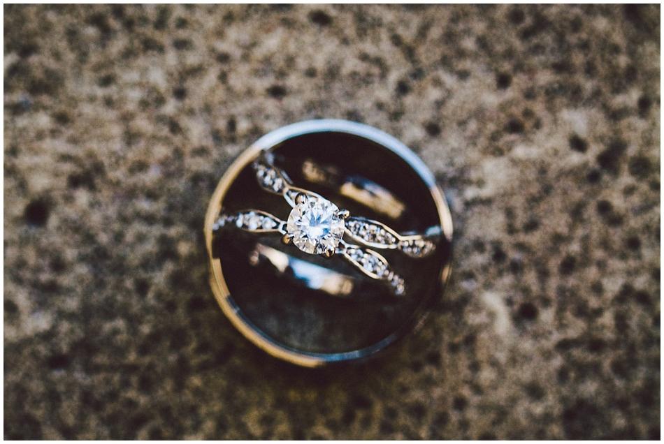wedding rings on sidewalk.  Bride's ring inside groom's ring