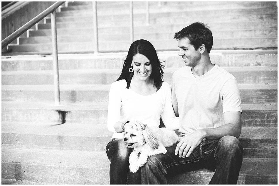 Engagement photos with dog - couple sitting on stairs