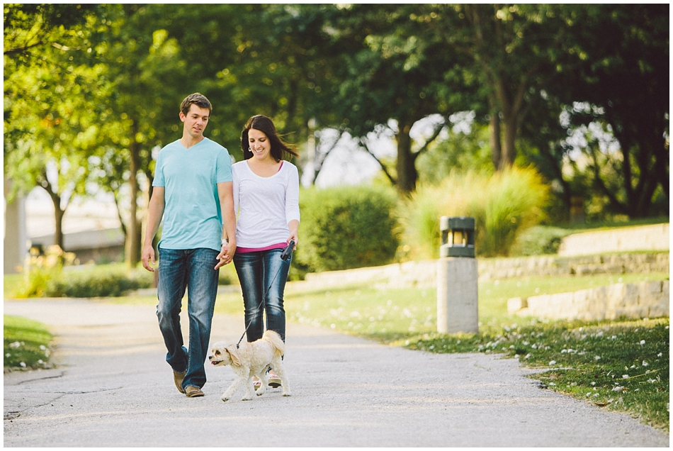 Couple walking their dog for engagement photos