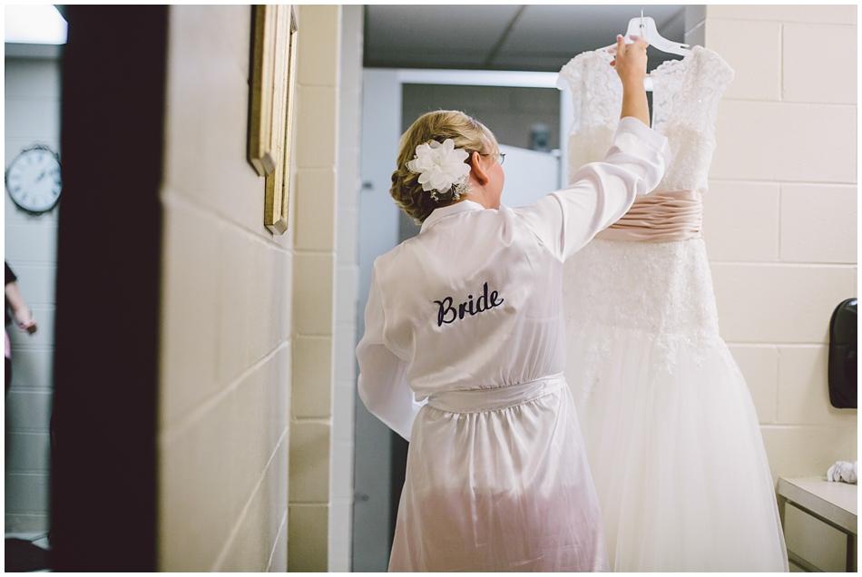 bride wearing robe with wedding dress