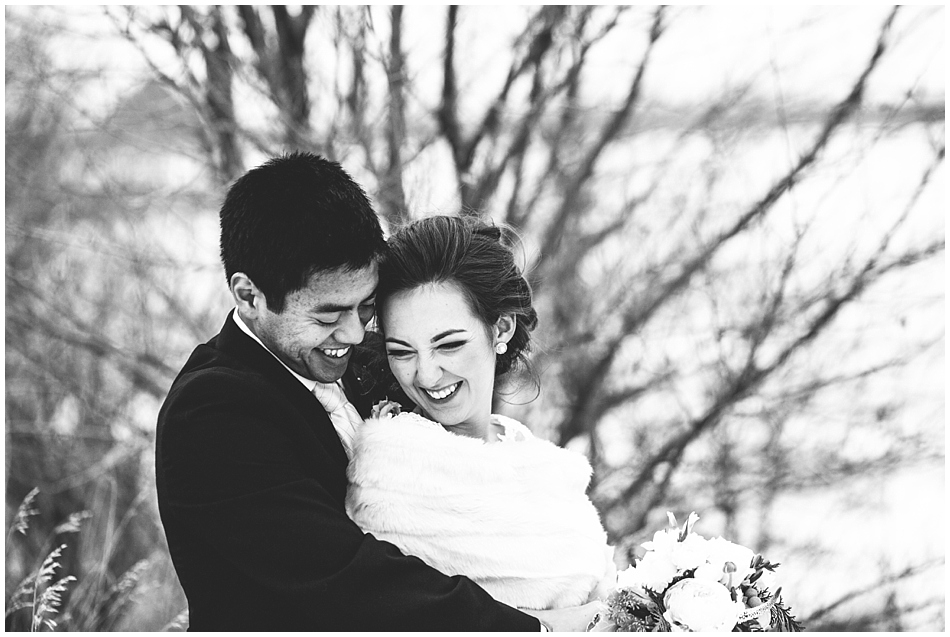 black and white photography bride and groom laughing