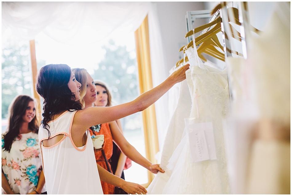 Bride picking out wedding dresses, photo by Amanda Kohler Photography