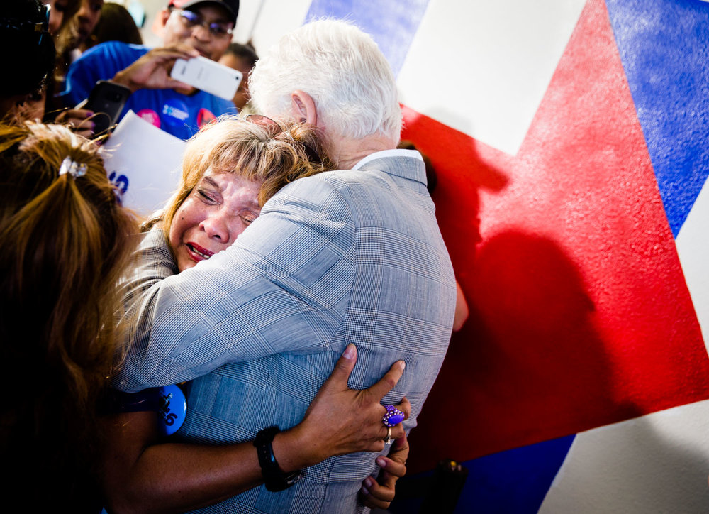 A woman hugs former President Bill Clinton at a campaign event in Las Vegas, NV on October 20, 2016. Photo for Hillary for America
