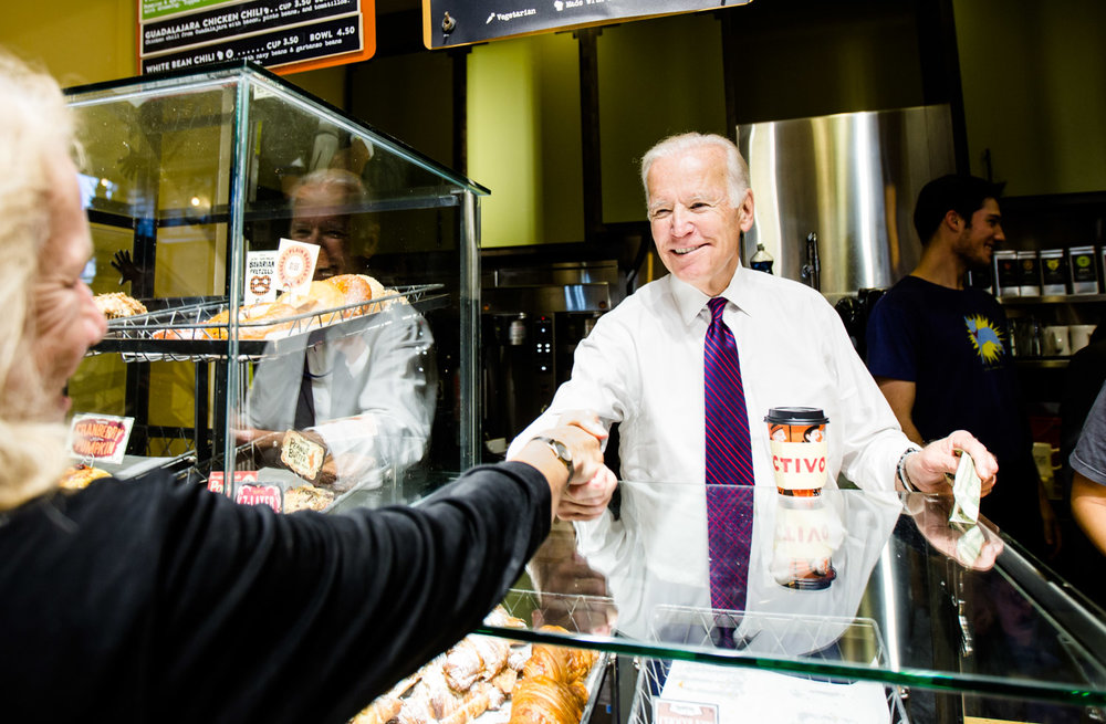 Vice President Joe Biden serves patrons at a coffee shop in Madison, WI on November 4, 2016. Photo for Hillary for America