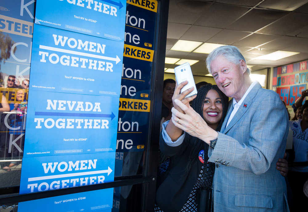 Former President Bill Clinton takes a photo with a supporter at a campaign event in Las Vegas, NV on October 20, 2016. Photo for Hillary for America