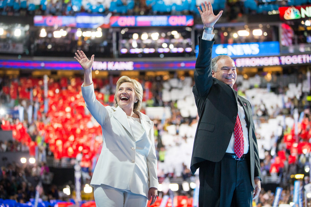Presidential Candidate Hillary Clinton and running mate Tim Kaine wave to the crowd at the Democratic National Convention after Clinton accepted the party nomination for president on July 28, 2016. Photo for the Democratic National Convention