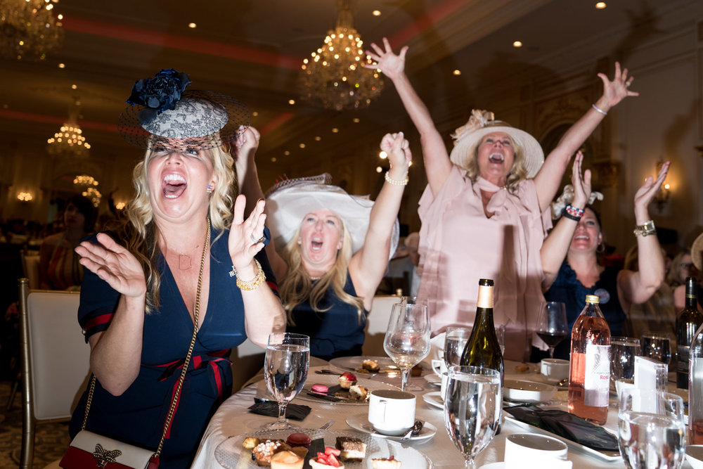 Women cheer at the Tea for Trump Birthday Extravaganza at the Trump Hotel in Washington, DC on June 24, 2018.